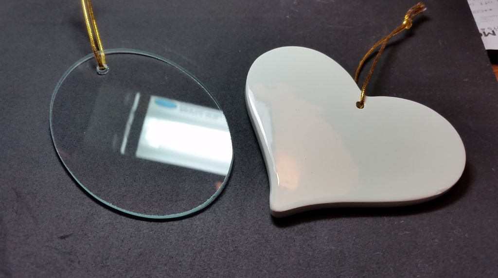 The two blank Christmas ornaments. On the left is the glass on (and the reflection of the Ott light is intentional, to show the surface texture), on the right is a ceramic heart.